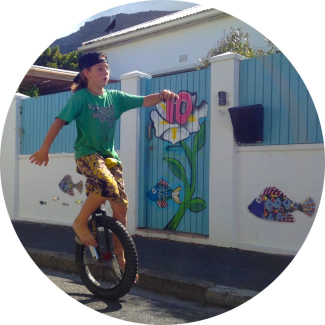 boy learns to ride a unicycle with lessons in south africa